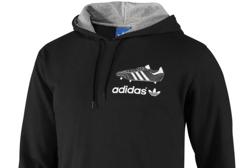 Pay homage to the past in this men's hooded sweatshirt, which features the history of adidas football boots screenprinted on the back. The hoodie is made of soft French terry.