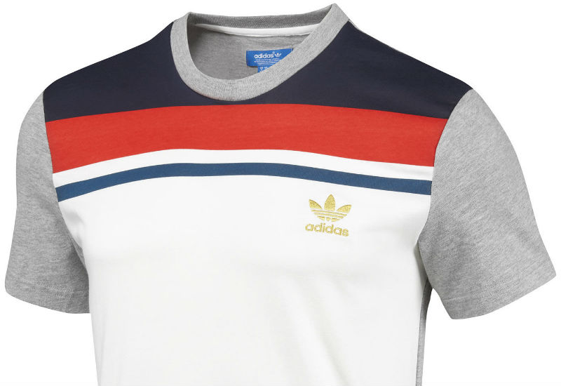 The Adidas England Football Tee pays tribute to the team's storied greatness. The t-shirt is made in soft 100% cotton and features blocks of colour on the sleeves and back.