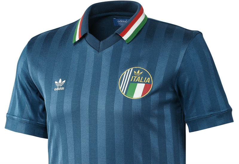 The bold style of Italian football is here in the Italy Retro Jersey. Cheer on gli Azzurri in this men's vintage football shirt. Features two-tone blue stripes and a polo-style collar.