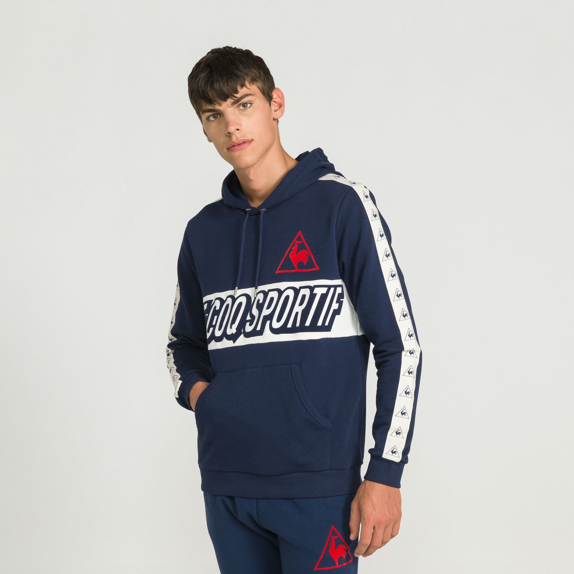 le coq sportif tricolore football pull over hood dress blues. Black Bedroom Furniture Sets. Home Design Ideas